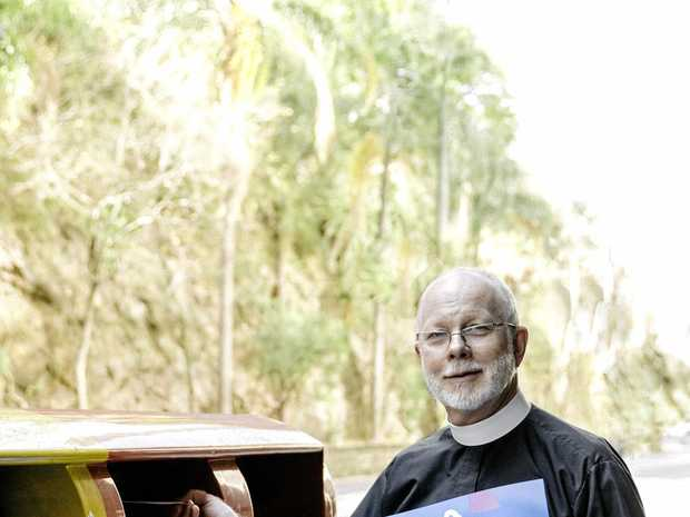 VOTE CAST: The Dean of Brisbane Dr Peter Catt posts his yes vote in the city recently. He explains why his church and many others are in favour of marriage equality.