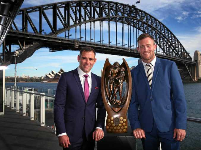 PRIZE: Storm captain Cameron Smith and Cowboys captain Gavin Cooper with the trophy at Luna Park in Sydney.
