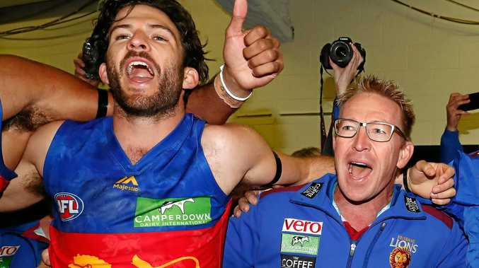 Brisbane general manager of football David Noble celebrates a Lions win with Rohan Bewick.