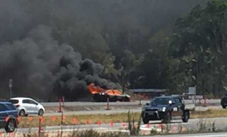 A car bursts into flames on the Bruce Hwy causing extensive traffic delays.