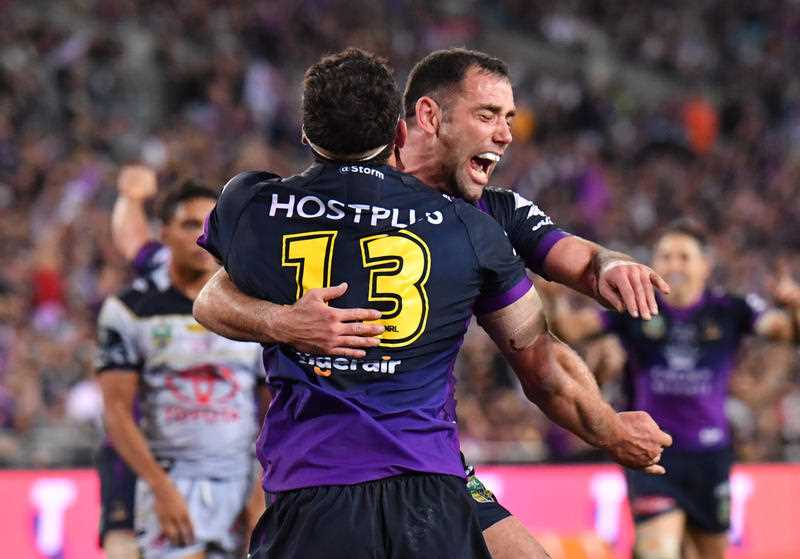 Dale Finucane and Cameron Smith of the Storm celebrate after Finucane scores a try during the NRL grand final between the Melbourne Storm and the North Queensland Cowboys at ANZ Stadium in Sydney, Sunday, October 1, 2017.