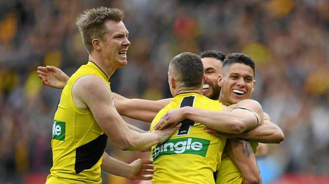 (L-R) Jack Riewoldt, Dustin Martin, Shane Edwards and Dion Prestia of the Tigers react after Prestia kicked a goal during the AFL grand final
