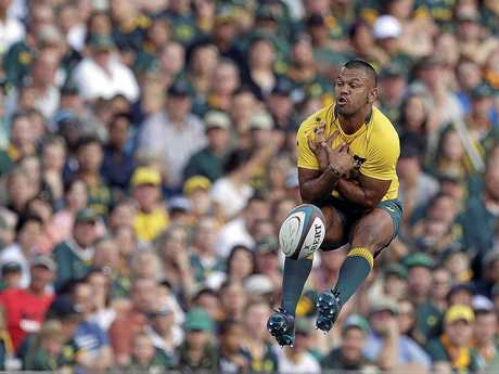 Australia's Kurtley Beale, jumps as he drops a catch