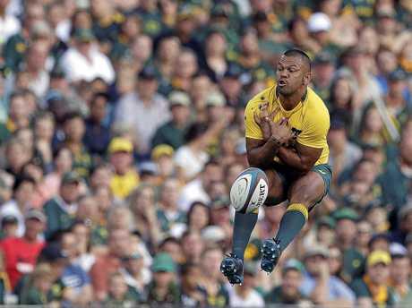 Australia's Kurtley Beale, jumps as he drops a catch