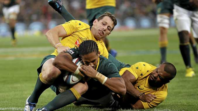 TOUCHING DOWN: Courtnall Skosan scores a try despite the attention of Australia's Bernard Foley (left) and Kurtley Beale.