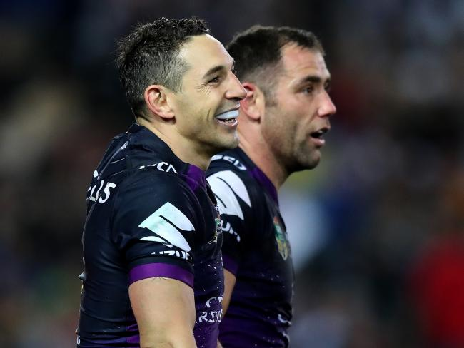 Melbourne's Cameron Smith and Billy Slater celebrate another try during the 2017 NRL Grand Final between the Melbourne Storm and the North Queensland Cowboys at ANZ Stadium, Sydney.