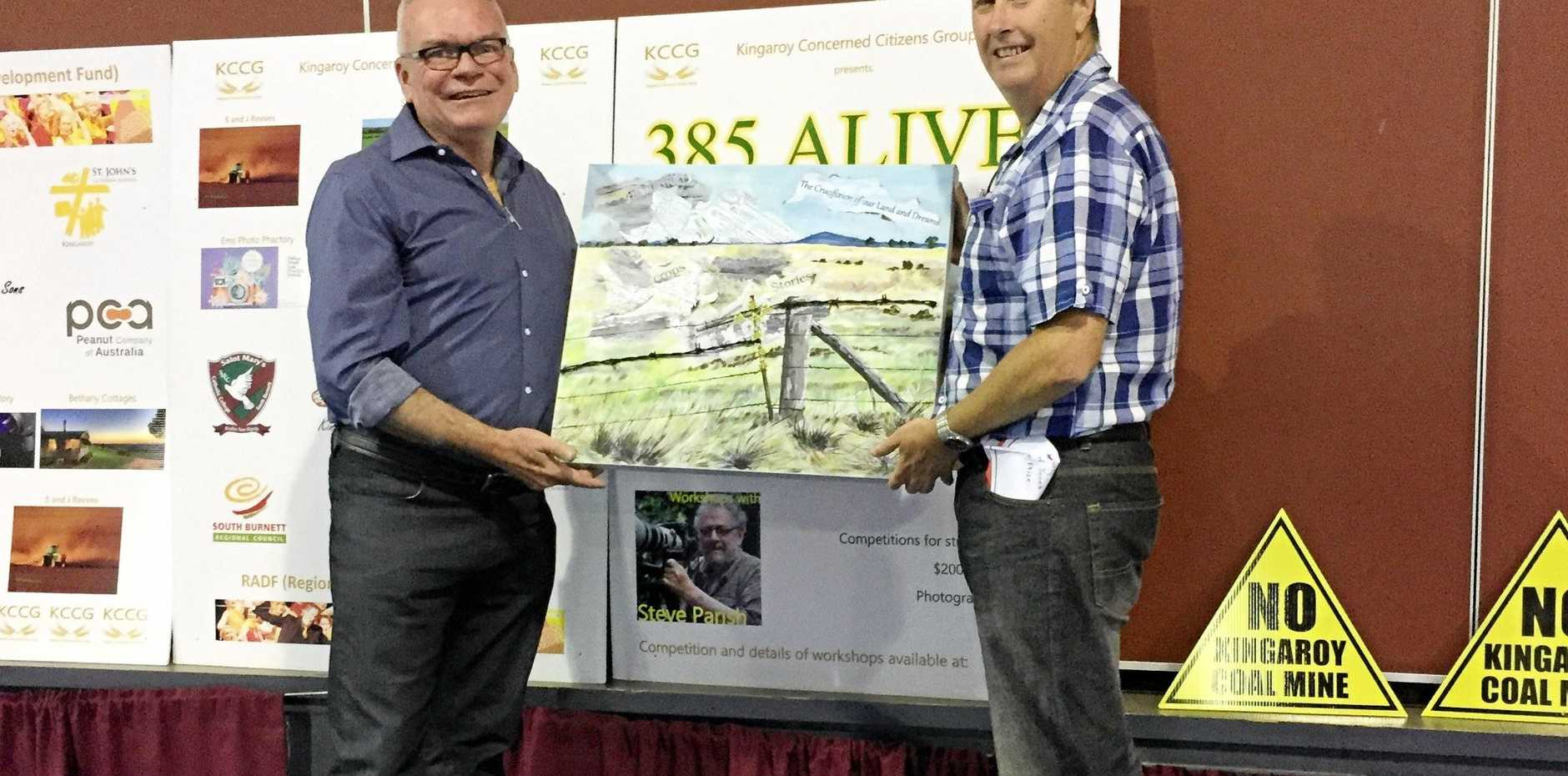Daryll Jones, pictured with judge Patrick Burns, won the painting award at the 385 Alive competition.