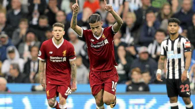 Liverpool's Philippe Coutinho celebrates scoring his side's goal in the 1-1 draw with Newcastle.
