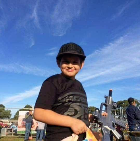 HAPPY BOY: Ten-year-old Jaymon Gaul is in intensive care fighting for his life after getting the flu.