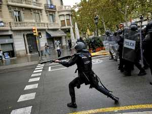 Catalan firies stand firm as cops beat them