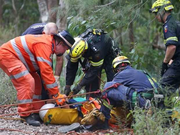 Emergency services rescued three international students who became trapped after one of their friends was injured when she fell about 20 meters down a a cliff at the Barron Falls Lookout. PICTURE: ANNA ROGERS