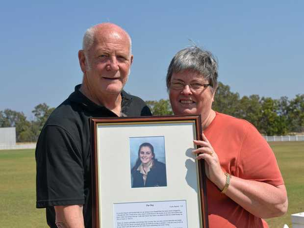 SORELY MISSED: Tom and Lindy Barton with a photo of their daughter Carly, which is framed alongside an essay she wrote, who passed away in 1997 after a 15 month battle with leukaemia.