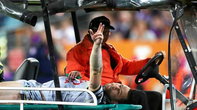 SAD DAY: Shaun Fensom is taken from the field after breaking his leg in the grand final.