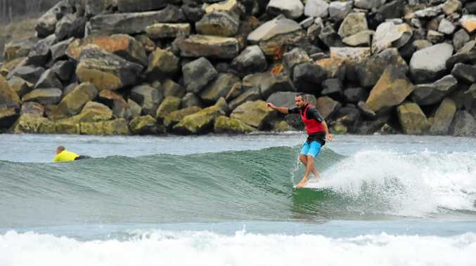 RIDING HIGH: Lennox surfer Scott Channon on his way to winning the Evans Head Malibu Classic on Monday.