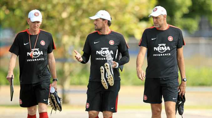Former Wanders coach Tony Popovic is flanked by the club's new temporary boss Hayden Foxe (left) and Zeljko Kalac.