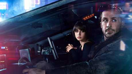 Ana de Armas and Ryan Gosling in a scene Blade Runner 2049.