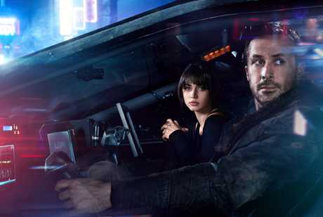 Ana de Armas and Ryan Gosling in a scene Blade Runner 2049.