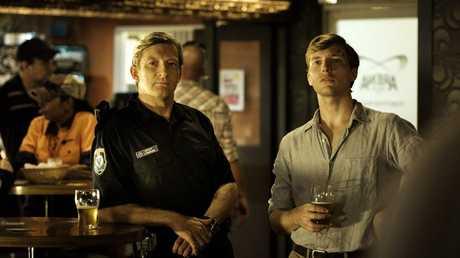 David Wenham plays Jock Crawford and Sean Keenan plays John Grant in the mini-series Wake In Fright.