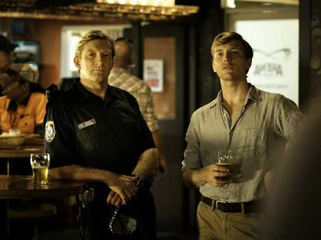 David Wenham plays Jock Crawford and Sean Keenan plays John Grant in the mini-series Wake In Fright.