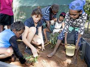 Kids dig in for garden task
