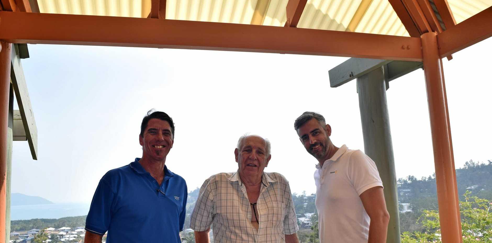SATISFIED: RPF tradesman Cody Johnston, Gergorio Prevato and Josh Cooney underneath the fixed veranda roof.