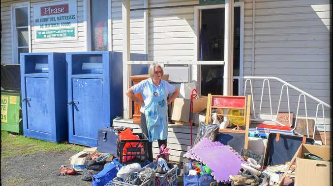 DUMPED: Volunteer Trish Templeton surveys the load of rubbish dumped overnight out the front of the Uniting Church Op Shop in Byron Bay.