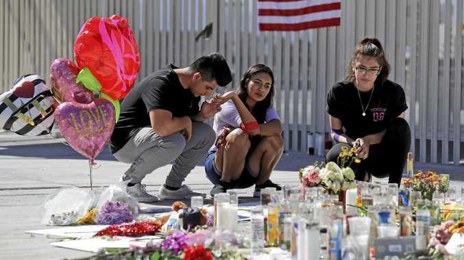 Las Vegas residents Roberto Lopez, Briana Calderon and Cynthia Olvera pause at a memorial site.
