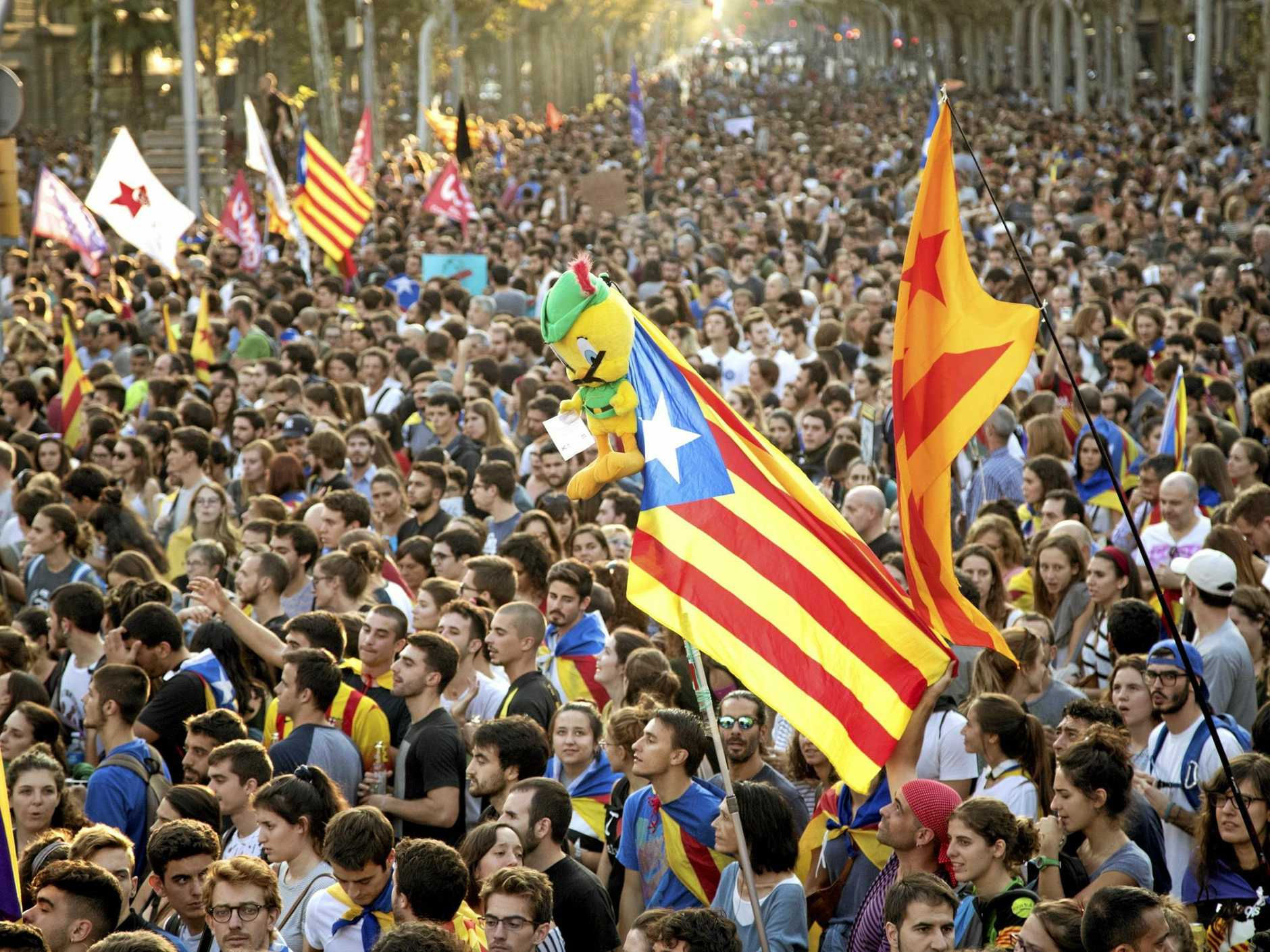 Tens of thousands demonstrate in Barcelona during a general strike following Sunday's referendum.