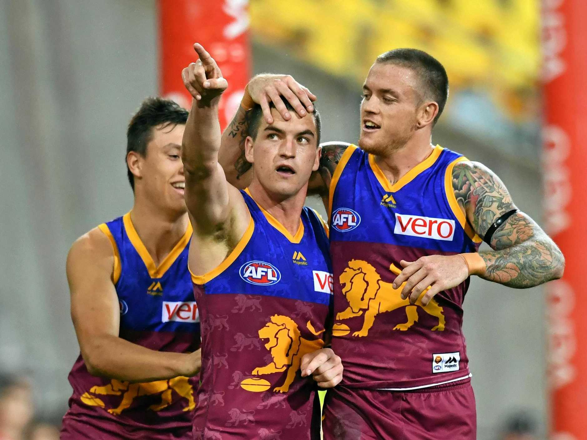 Tom Rockliff (centre) seems set to be traded to Port Adelaide.