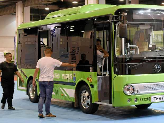 Visitors look at an electric bus during the 7th China International Green Vehicle Industry Expo Hangzhou (GVE China 2017) in Hangzhou city, east China's Zhejiang province, September 15, 2017.