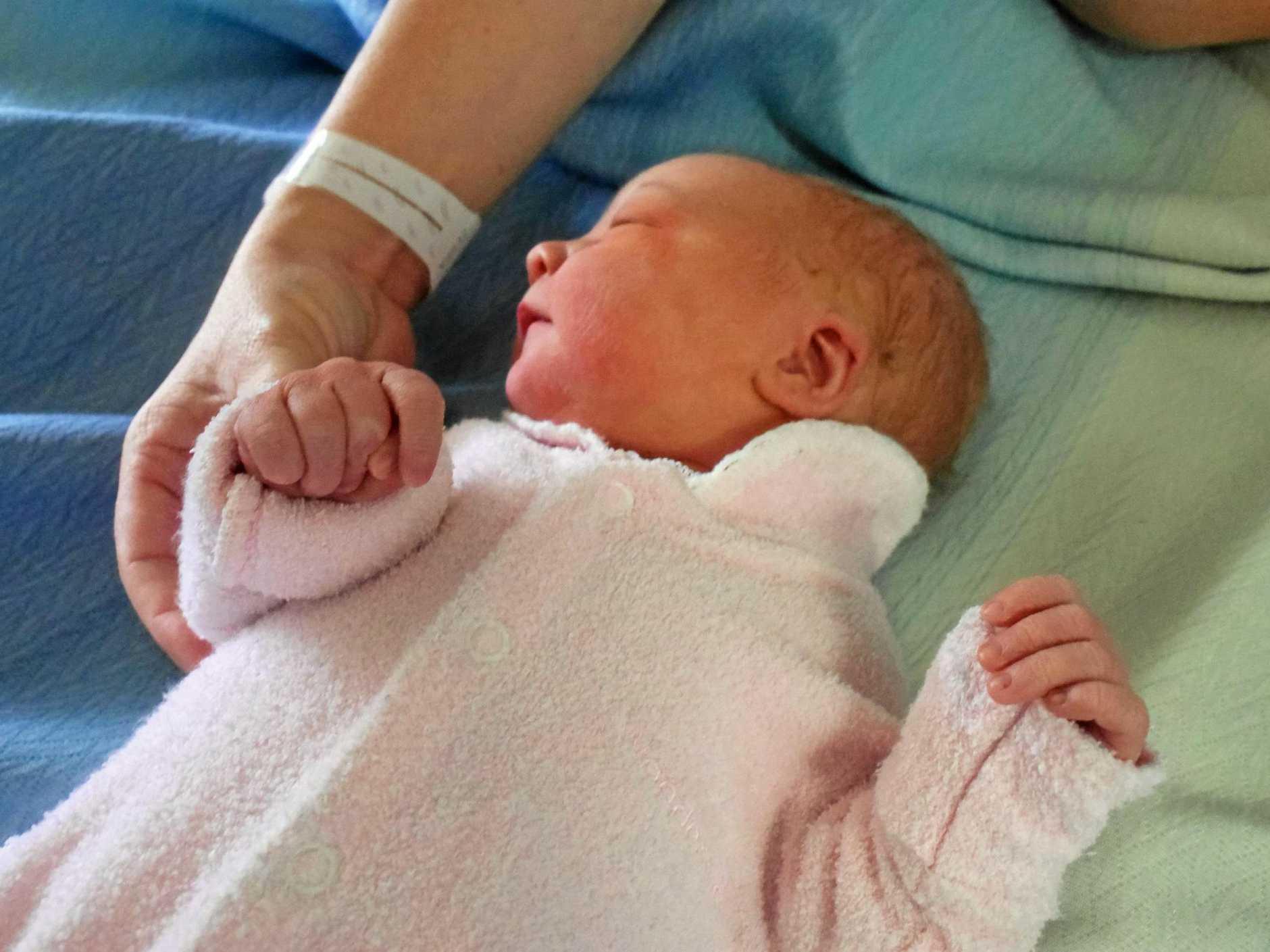 Newborn Chloe Jaide Euler sleeps peacefully at the Gladstone Hospital.