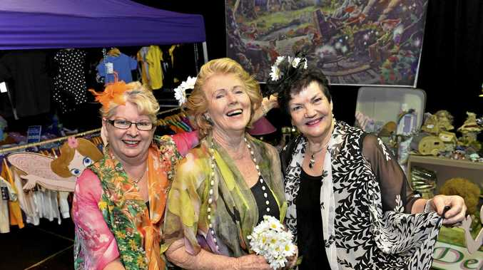 Liz Davenport fashion consultants (from left) Donna Molnar, Janet Kent and Marilyn Little have some fun.