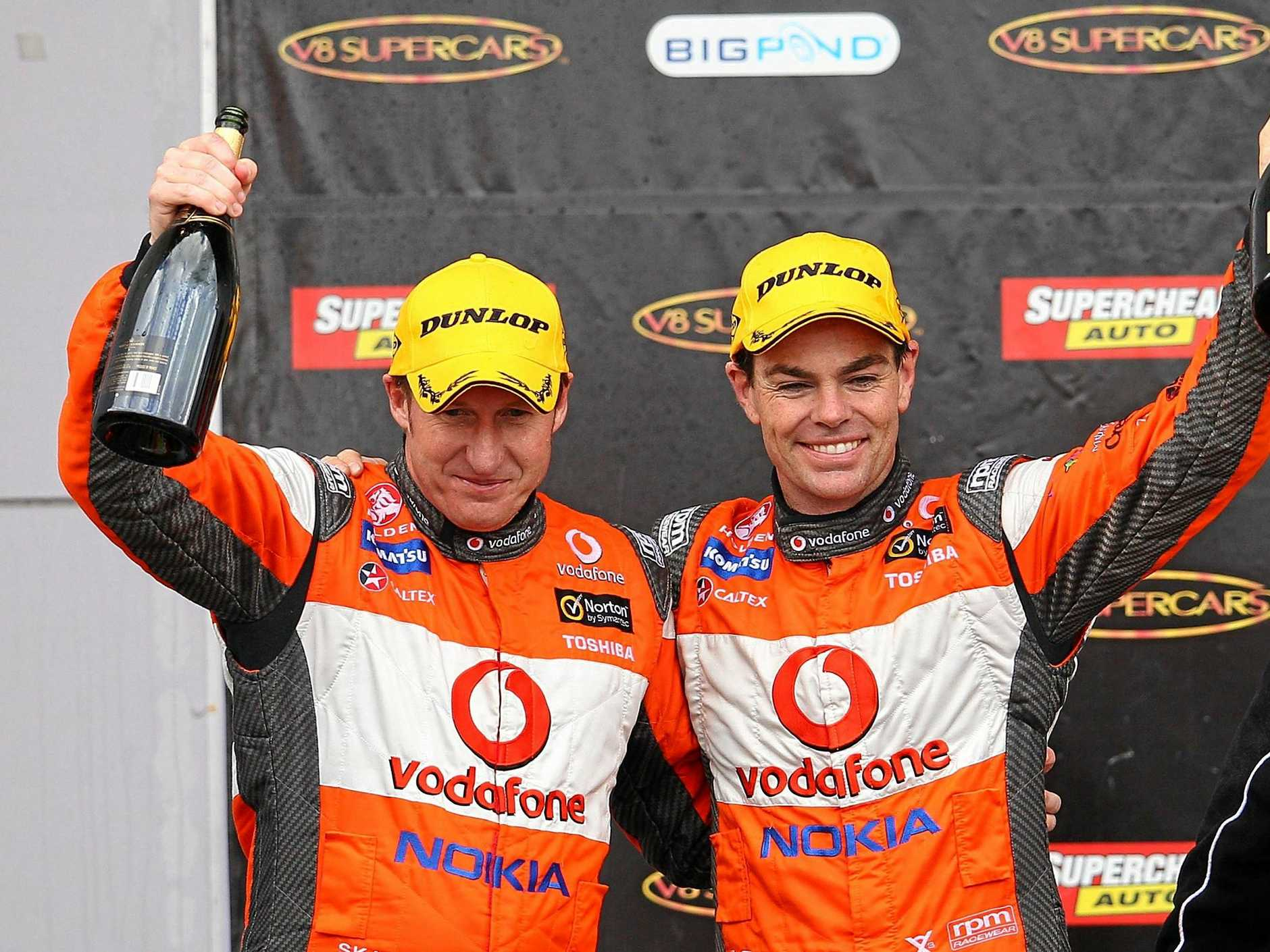 BATHURST, AUSTRALIA - OCTOBER 09:  Mark Skaife and Craig Lowndes drivers of the #888 Team Vodafone Holden celebrate on the podium after finishing second after the Bathurst 1000, which is round 10 of the V8 Supercars Championship Series at Mount Panorama on October 9, 2011 in Bathurst, Australia.  (Photo by Matt Blyth/Getty Images)