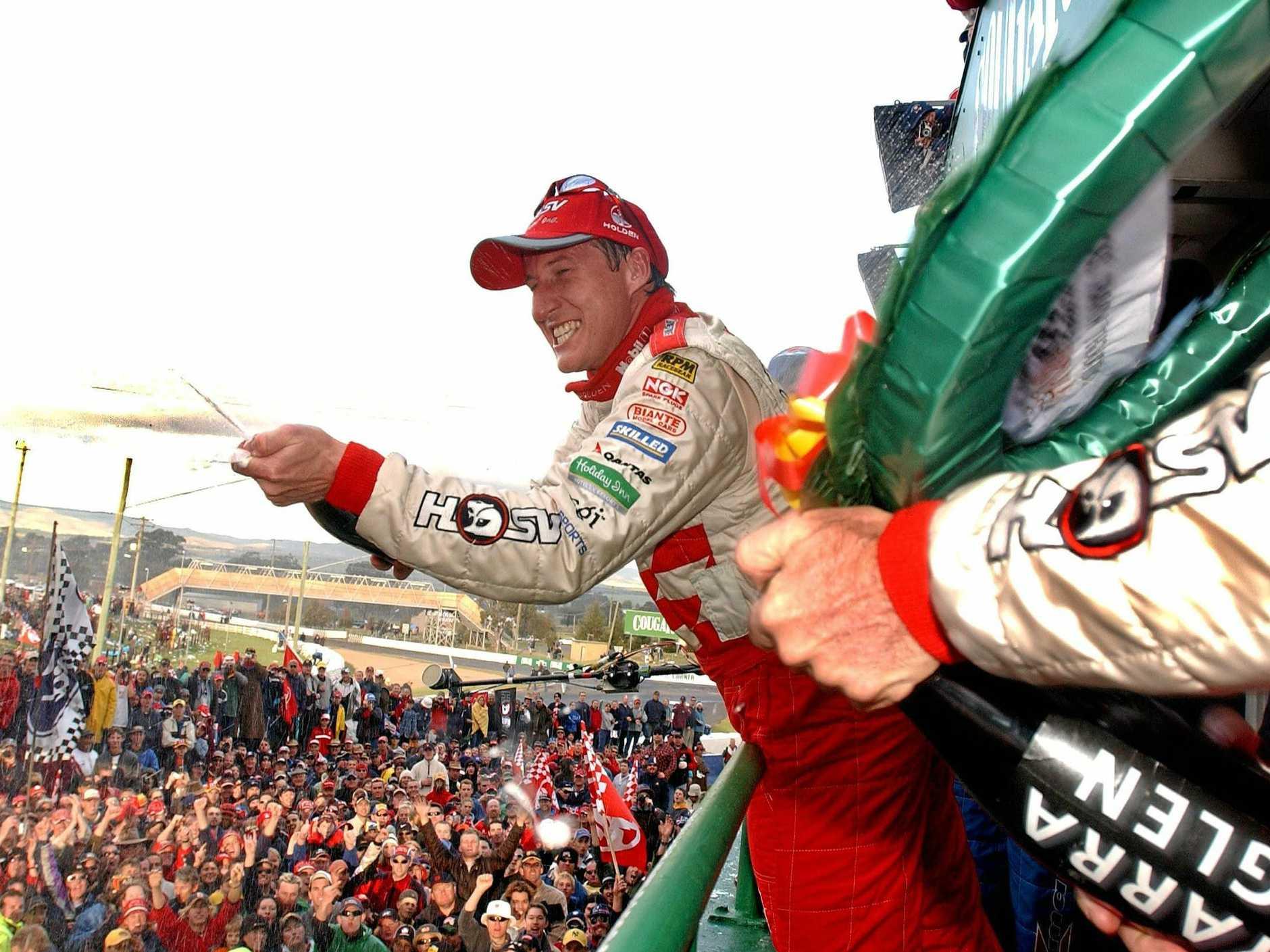 07 Oct 2001:  Mark Skaife of the Holden Racing team sprays champagne after taking victory in the Bathurst 1000 V8 Supercar race held at Mt Panormama, Bathurst, Australia.  DIGITAL IMAGE Mandatory Credit: Chris McGrath/ALLSPORT