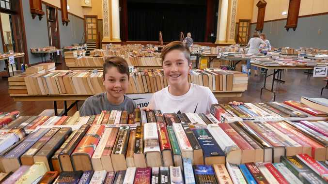 Volunteers Lachlan and Aidan Stone from Toowoomba who helped set up the Bookfest and serve the many customers.