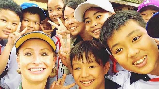 SMILE: Teacher Bridge Muir with children from Ngô Quyên School.