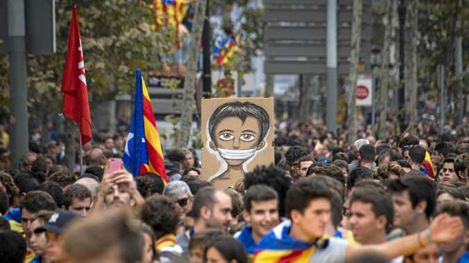 Protesters march in the streets of Barcelona to protest police violence during the Catalonia independence referendum.