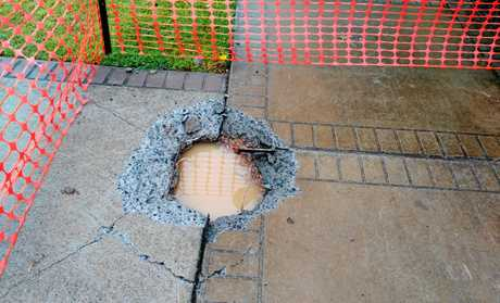 SMOULDERING: The crater caused by a lighting strike on Parklands Blvd on Sunday evening.