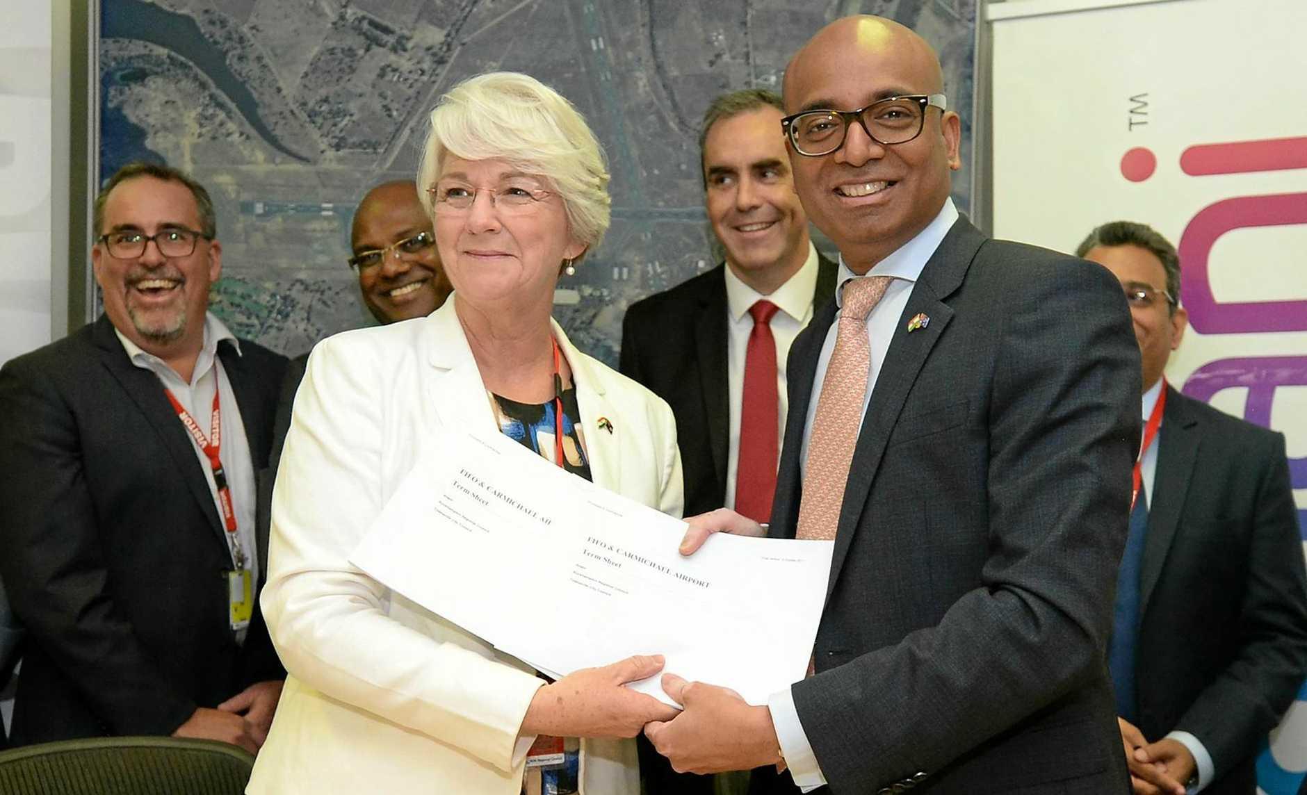 DONE DEAL: Rockhampton Mayor Margaret Stelow with Adani Australia CEO Jeyakumar Janakaraj sign the MOU regarding the Charmichael Mine FIFO hub at Rockhampton Airport on Thursday.