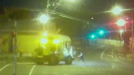 CCTV has captured the moment a woman is hit by a truck in Brisbane this morning.