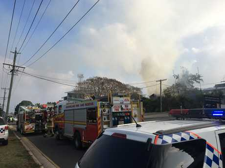 Fireies, police and paramedics are at the scene of a two-storey home engulfed in flames. Thick, black smoke can be seen from kilometres away.