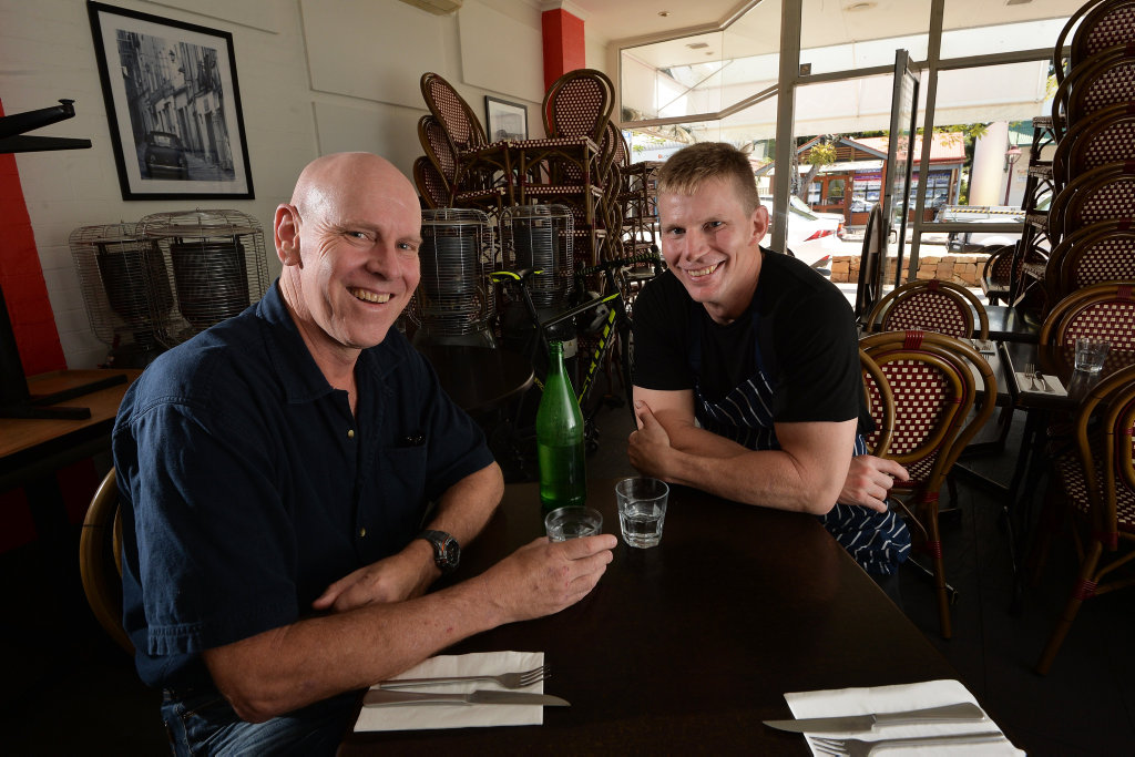 Landscape architect Rob Burrell had a major heart attack while riding his bike in Buderim last month. Rob Burrell and Milans Pizza and Pasta restaurant owner Brad Lovaas (right).