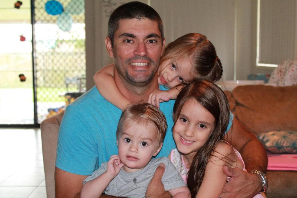 Bradley Davis with his beloved children, Baillee, Maddison and Jason