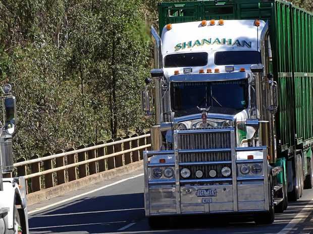 ON THE ROAD: A schmick Kenworth of Shanahans crossed Dogwood Creek at Miles in Queensland.