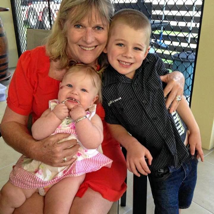 Lynn Murray put a call out on Facebook to find her 'hero' who saved her life when she was caught in a rip at Lamberts Beach 25 years ago. She's pictured here with two of her grandkids.