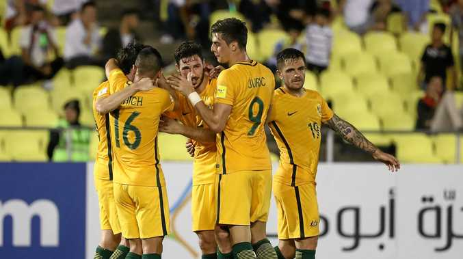 Socceroos players celebrate Robbie Kruse's goal in the 1-1 draw with Syria.