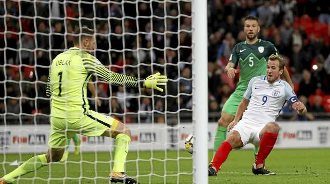 Harry Kane books England's ticket to the World Cup finals in Russia with a late goal against Slovenia.