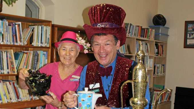 Fay Thorogood and George Hoad with the teapot competition entries.