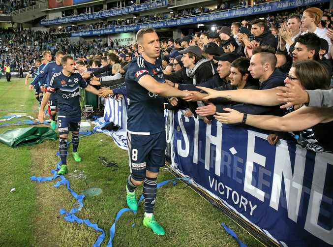Melbourne Victory's Besart Berisha leads his team as they greet some of the Melbourne fans after losing the 2016-17 A-League grand final.