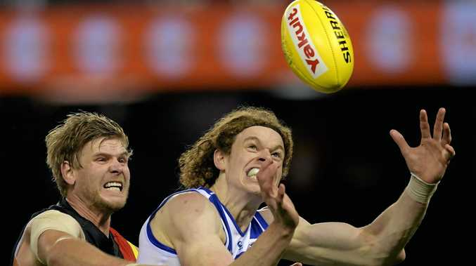 Ben Brown (right) has extended his contract with North Melbourne until the end of the 2020 season.